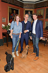 Left to right, BRIDIE HALL, PHIL ATHILL and TOM EDWARDS with dogs Max & Fraser at a party to celebrate the publication of English Houses by Ben Pentreath held at the Art Worker's Guild, 6 Queen Square, London on 28th September 2016.