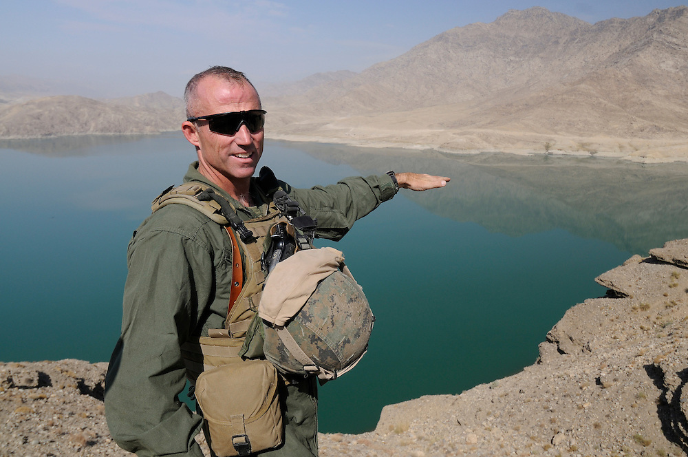 """US Marine Colonel Jeff Haynes, Commanding Officer, 201st Regional Corps Advisory Command, on a ridge overlooking the Naghlu reservoir and the road leading into the Tagab Valley. ..  ..One of the main tactics is a new road through Tagab Valley that will allow traffic to bypass Kabul providing a more direct link between Pakistan and destinations north including Uzbekistan and Tajikistan.....To win the Tagab Valley, Colonel Haynes said, """"The creeping barrage of goodness, really centers on the road going up the valley, because then you can begin development projects and increase prosperity.  The cab fare for villagers went from $8 down to $1 just because the ANA graded the road.""""  As the ANA move north through the valley they are building combat outposts to sustain the gains.  Haynes confirmed this is an ANA campaign - the first of its kind - his soldiers are mentoring the ANA, there are no coalition troops.  .."""