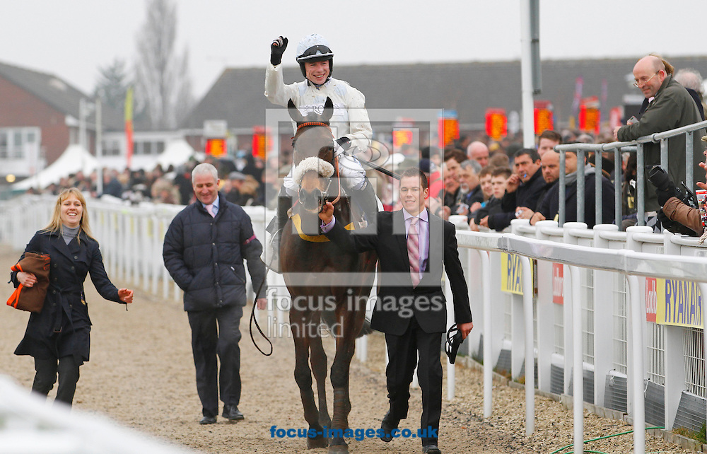 Picture by John Hoy/Focus Images Ltd. 07583422396.15/03/12.Pertemps Final hurdle winner Cape Tribulation and Denis O'Regan parading in front of the crowd at Cheltenham Race Course, Gloucestershire.