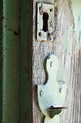 weathered door with old style handle and lock