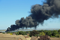 © Licensed to London News Pictures. 31/08/2013.  Smoke plumed acoss Gravesend today and over 10 fire appliances were called to the scene when an industrial fire broke out on the Gravesend riverside. The smoke could be seen from miles away on either side of the Thames. Credit : Rob Powell/LNP