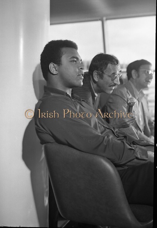 Muhammad Ali In Dublin..1972..11.07.1972..07.11.1972..11th July 1972. Prior to his fight against Al 'Blue' Lewis at Croke Park, Dublin, former World Heavyweight Champion, Muhammad Ali arrives at Dublin Airport. The fight was part of his build up for for a championship fight against the current World Champion, 'Smokin'  Joe Frazier. Ali had been stripped of the title partly due to his refusal to join the American military during the Vietnam War,which he had opposed...Image of Muhammad Ali, boxing promoter Harold Conrad, and trainer Angelo Dundee, as they take questions from the assembled media.
