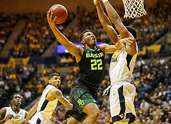 Jan 9, 2018; Morgantown, WV, USA; Baylor Bears guard King McClure (22) drives down the lane and shoots during the first half against the West Virginia Mountaineers at WVU Coliseum. Mandatory Credit: Ben Queen-USA TODAY Sports
