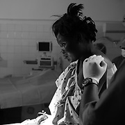 Diana sits in the Operating Room waiting to receive an epidural before an emergency caesarean section performed by Drs. Shirazian and Strong of Saving Mothers at the Kapenguria County Referral Hospital in Kapenguria, Kenya on March 6, 2018.