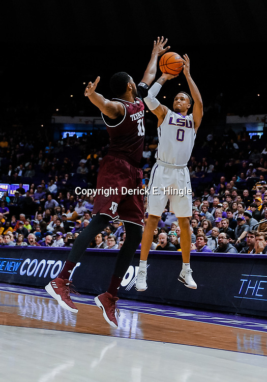 Jan 23, 2018; Baton Rouge, LA, USA; LSU Tigers guard Brandon Sampson (0) shoots over Texas A&M Aggies guard Mark French (11) during the second half at the Pete Maravich Assembly Center. LSU defeated Texas A&M 77-65. Mandatory Credit: Derick E. Hingle-USA TODAY Sports