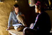 The Guardian writer Zoe Williams speaks to Tulasa Khadka, 14, who got married when she was 13 and gave birth to a stillborn baby weighing less than 1kg a week ago, as she rests at home in the remote village of Dungi Khola, near Chhinchu, Surkhet district, Western Nepal, on 1st July 2012. Tulasa eloped one year ago and didn't use contraceptives. She walks through the hills to the nearest hospital and she went into labour while on her way there for a checkup at almost full term. In Surkhet, Save the Children partners with Safer Society, a local NGO which advocates for child rights and against child marriage. Photo by Suzanne Lee for Save The Children UK