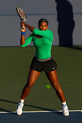 July 26, 2011; Stanford, CA, USA;  Serena Williams (USA) returns the ball against Anastasia Rodionova (AUS), not pictured, during the first round of the Bank of the West Classic women's tennis tournament at the Taube Family Tennis Stadium.