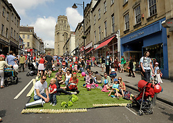 © Licensed to London News Pictures. 01/06/2014; Bristol, UK.  Bristol's famous Park Street is turned into a pedestrianised park for the Make Sunday Special series of events by Bristol's elected Mayor George Ferguson, once a month in the summer.  Artificial grass was laid out and stalls and entertainment provided.<br /> Photo credit: Simon Chapman/LNP