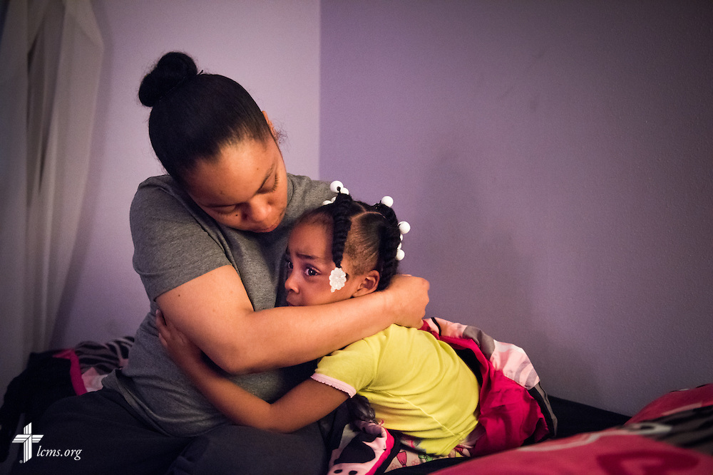 Nyia Harrell comforts her daughter Jada Harrell during bedtime at A Place of Refuge on Tuesday, Sept. 1, 2015, in Milwaukee, Wis. LCMS Communications/Erik M. Lunsford