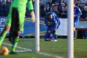 AFC Wimbledon midfielder Dean Parrett (18) scores a goal 1-1 and celebrates during the EFL Sky Bet League 1 match between AFC Wimbledon and Oxford United at the Cherry Red Records Stadium, Kingston, England on 14 January 2017. Photo by Stuart Butcher.