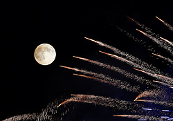 Fireworks streak past in front of the supermoon outside the town of Mosta, celebrating the feast of its patron saint, in central Malta, August 10, 2014. The astronomical event occurs when the moon is closest to the Earth in its orbit, making it appear much larger and brighter than usual.<br /> REUTERS/Darrin Zammit Lupi (MALTA)
