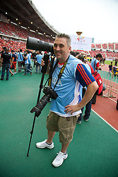 BANGKOK, THAILAND - Sunday, July 28, 2013: Liverpool Echo photographer Jason Roberts during a preseason friendly match at the Rajamangala National Stadium. (Pic by David Rawcliffe/Propaganda)