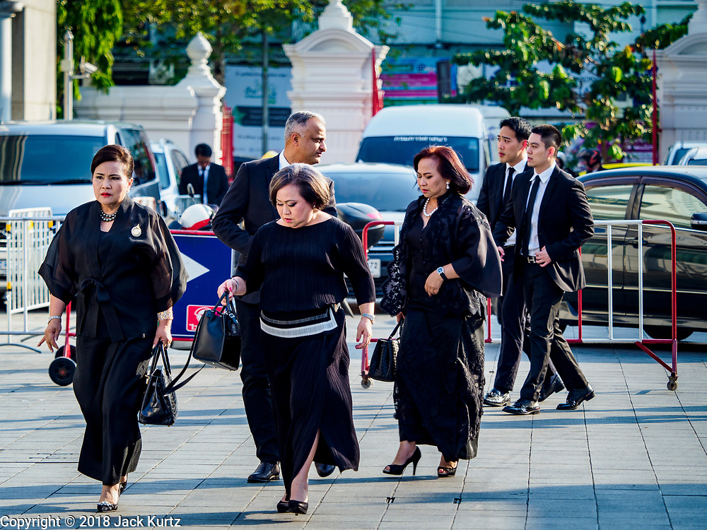 03 NOVEMBER 2018 - BANGKOK, THAILAND: Friends and family of Vichai Srivaddhanaprabha walk into Wat Debsirin for the first day of Vichai's funeral rites. Vichai was the owner of King Power, a Thai duty free conglomerate, and the Leicester City Club, a British Premier League football (soccer) team. He died in a helicopter crash in the parking lot of the King Power stadium in Leicester after a match on October 27. Vichai was Thailand's 5th richest man. The funeral is expected to last one week.  PHOTO BY JACK KURTZ