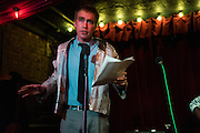 "Dec. 6, 2013 - Brooklyn, NY. Adam Warner delivers the news poetically in ""Wear the Newscast"" at the Audiofiles lives show in the Jalopy Theatre. 12/6/13 Photograph by Julius C. Motal/CUNY Journalism PHOTO"