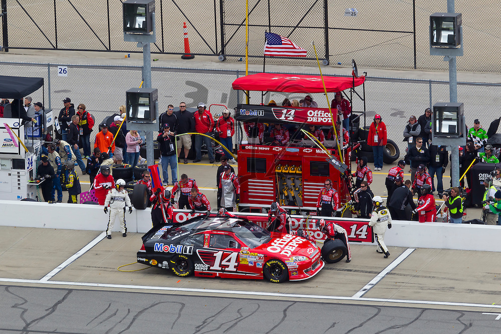 KANSAS CITY, KS - APR 22, 2012:  Tony Stewart (14) races during the STP 400 at the Kansas Speedway in Kansas City, KS.