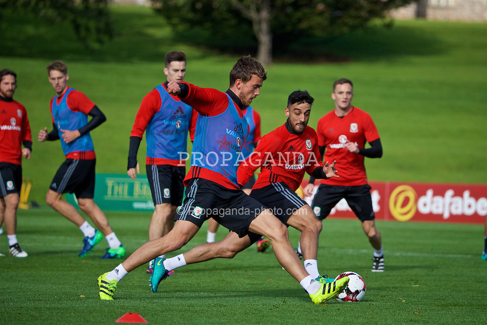 CARDIFF, WALES - Wednesday, October 5, 2016: Wales' Emyr Huws and Neil Taylor during a training session at the Vale Resort ahead of the 2018 FIFA World Cup Qualifying Group D match against Austria. (Pic by David Rawcliffe/Propaganda)