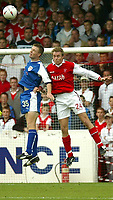 Photo. Andrew Unwin<br /> Rotherham v Millwall, Nationwide League Division One, Millmoor Lane, Rotherham 11/10/2003.<br /> Millwall's Tony Craig (l) outjumps Rotherham's Chris Sedgwich (r) for the ball.
