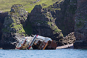 Shipwreck disaster of French fishing trawler ship grounded on rocks by the remote Isle of Rhum - Rum - part of the Inner Hebrides and the Western Isles of Scotland