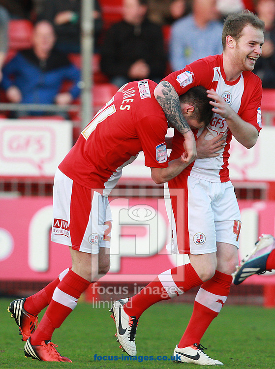 Picture by Paul Terry/Focus Images Ltd +44 7545 642257.23/04/2013.Mike Jones ( L ) of Crawley Town celebrates withMark Connolly after scoring the opening goal during the npower League 1 match at Broadfield Stadium, Crawley.