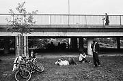 Conversations under the bridge vs chilling on the grass, 12v Teknival, Bristol, UK, November 2011
