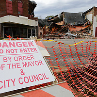 Thomas Wells | BUY AT PHOTOS.DJOURNAL.COM<br /> Okolona Main Street is blocked off following a building collpase following Tuesday's storms. The building was in fear of collapse weeks ago due to structural failure and the building couoldn't withstnd the high winds from Tuesday night.