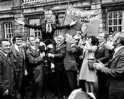 The Wests Awake! Supporters carry the new Fine gael Deputy for West Mayo, Enda Kenny, shoulder-high on his first day in Dail Eireann. Enda Kenny would become Taoiseach in 2011.<br />