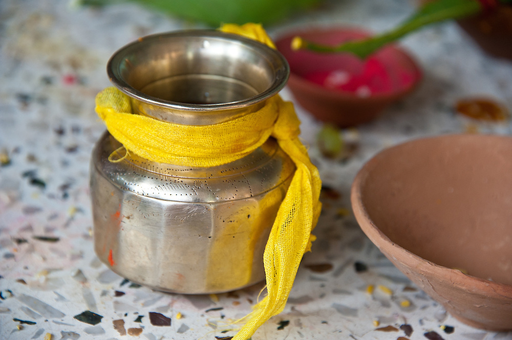 Pithi or Haldi, the cleansing ceremony is practiced during which the bride and bridegroom are pasted with turmeric powder in their respective homes, as a part of their beautification process.