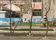 Pyongyang, North Korea. Fresco decorating a wall in a school, the american is symbolised by the wolf killed by the North Korean soldier.