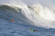 "Grant ""Twiggy"" Baker drops into a giant wave during the first heat of the Mavericks surf contest Saturday, Feb. 13, 2010, in Half Moon Bay, California"