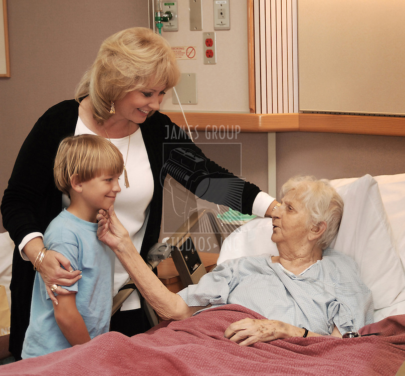 family visiting grandmother in hospice