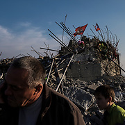 Locals inspect the destroyed Savur-Mohyla Memorial, a WWII memorial complex on a strategic height near the city of Snizhne, close to the border with Russia in Donetsk Oblast. The site was destroyed in 2014 during heavy fighting between pro-Russian separatists and Ukrainian armed forces.