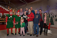 "Tinsel and Twinkle welcome Skylor Miller as she receives the key as ""Mayor"" of Christmas Village from Ed Engler on opening night.  (l-r back row) Scott Myers, Wes Anderson, Luke Powell, Henry Lipman and Bessie Lipman.  (l-r front row) Twinkle, Tinsel, Skylor Miller, Xavier Corbin, Ed Engler and Bob Hamel.   (Karen Bobotas/for the Laconia Daily Sun)"