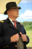 Old Bethpage, New York, USA - July 21, 2012: GUY SMITH of Huntington, NY, portrays Regimental Adjutant at Headquarters, at re-creation of Camp Scott, a Union Army training camp, at Old Bethpage Village Restoration, to commemorate 150th Anniversary of American Civil War.