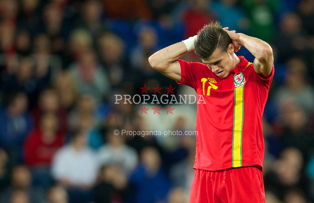 CARDIFF, WALES - Tuesday, September 10, 2013: Wales' Gareth Bale looks dejected against Serbia during the 2014 FIFA World Cup Brazil Qualifying Group A match at the Cardiff CIty Stadium. (Pic by David Rawcliffe/Propaganda)