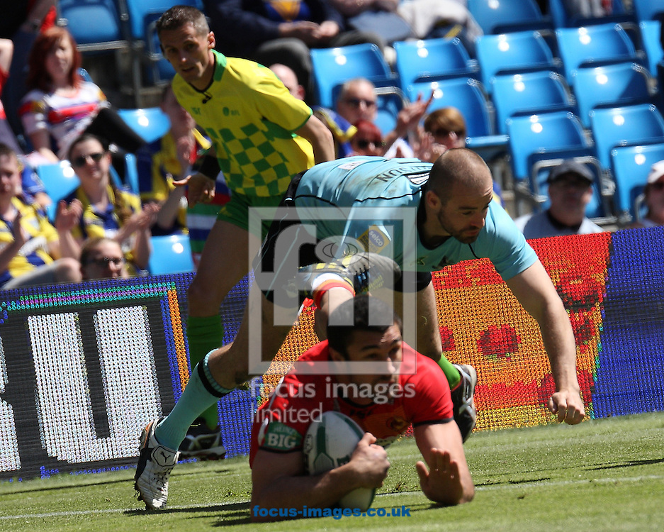 Picture by Stephen Gaunt/Focus Images Ltd +447904 833202.25/05/2013.Fredric Vaccari of Catalans Dragons scores the try against London Broncos during the Super League match at the Etihad Stadium, Manchester.