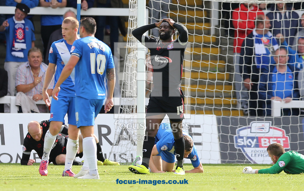 Jabo Ibehre (14) of Carlisle United reacts to a missed chance during the Sky Bet League 2 match at Victoria Park, Hartlepool<br /> Picture by Simon Moore/Focus Images Ltd 07807 671782<br /> 29/08/2015