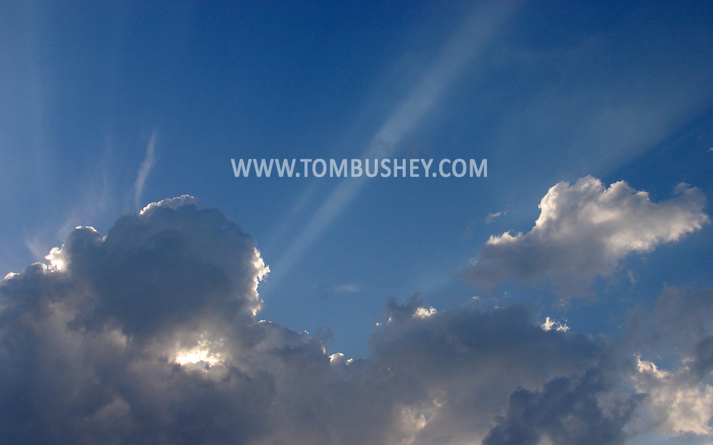 Middletown, N.Y. - Rays of sunlight shoot from behind a cloud on June 28, 2006. ©Tom Bushey