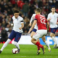 Jordan Sancho of England with Filip Novak of Czech Republic defending