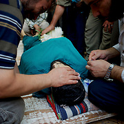 August 09, 2012 - Marea, Aleppo, Syria: Family members and friends mourn the death of Housin Al Ali, a 28 year old Free Syria Army fighter killed in combat in Alepo's Salehedine neighborhood...The Syrian army and the FSA have in the past week exchanged heavy fire in a battle for the control of Syria's economic capital, Aleppo.