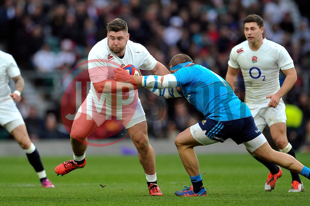 Kieran Brookes of England fends Matias Aguero of Italy - Photo mandatory by-line: Patrick Khachfe/JMP - Mobile: 07966 386802 14/02/2015 - SPORT - RUGBY UNION - London - Twickenham Stadium - England v Italy - Six Nations Championship