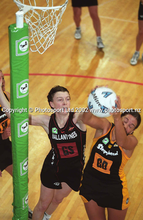 Angela Evans and Debbie Matoe in action during the National Bank Cup netball match between the Wellington Shakers and Canterbury Flames, 20 April, 2002. Photo: Sandra Teddy/PHOTOSPORT *** Local Caption ***