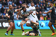 London Irish back row Albert Tuisue (8) breaks a tackle during the Gallagher Premiership Rugby match between Wasps and London Irish at the Ricoh Arena, Coventry, England on 20 October 2019.
