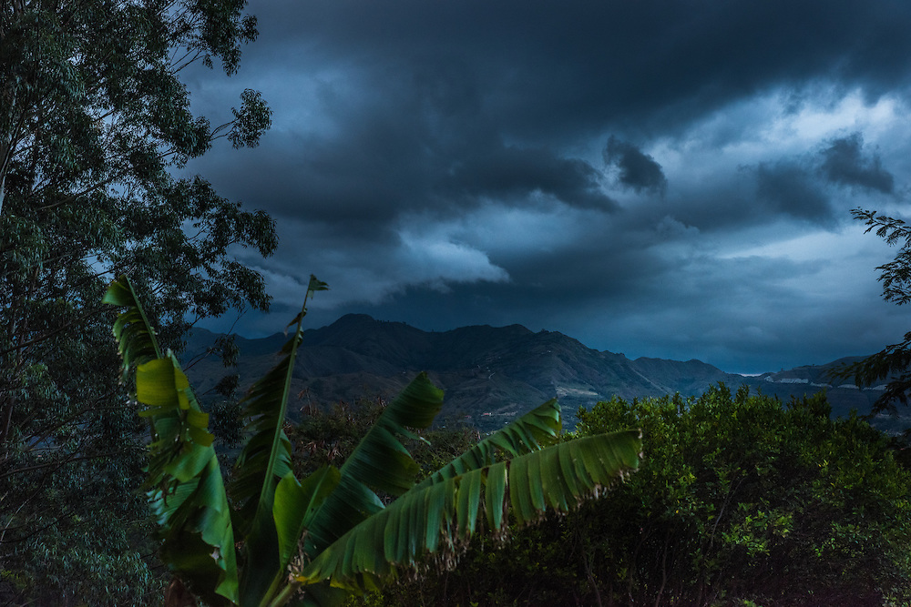 The sun sets and the night kicks in while a storm develops, Vilcabamba, Ecuador.