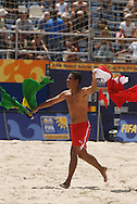 Football-FIFA Beach Soccer World Cup 2006 - Group D-BHR_NGA - Adnan Ebrahim celebrates the victory of Bahrain holding the flags of Brazil his born place and Bahrain his Beach soccer team - Rio de Janeiro - Brazil 06/11/2006<br />Mandatory credit: FIFA/ Marco Antonio Rezende.