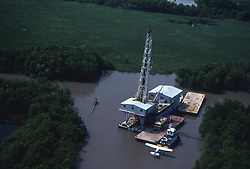 Stock photo of offshore Barge drilling rig in marshes of south Louisiana.