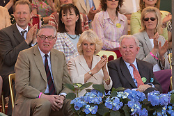 The Duchess of Cornwall ( seated with Lord Vestey and the Earl of Halifax attends the last day of the Mitsubishi Motors Badminton Horse Trials 2013 to present the prizes. Monday 06  May  2013.  Badminton, Gloucs, UK..Photo by: Mark Chappell/i-Images