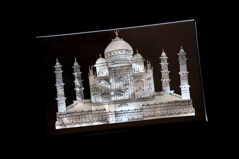 Taj Mahal souvenir, mother of pearl inlay on black onyx marble, on sale at Subhash Emporium, Agra, India