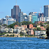 North Sydney Skyline in Sydney, Australia<br /> Most tourists spend their vacation in and around Sydney&rsquo;s Central Business District. On the other side of the harbour is North Sydney. This commercial zone has the second largest cluster of high-rises in New South Wales. Numerous international companies office here, including tech firms like Cisco Systems and Sun Microsystems. On the right is Robertson's Point Light. The 26 foot beacon was secured at the end of Cremorne Point in 1910.