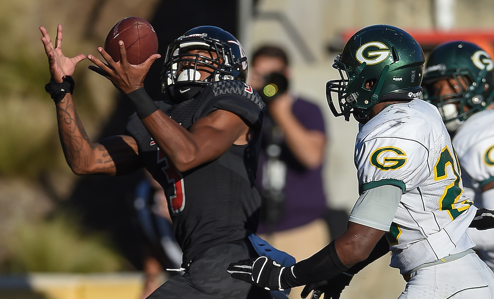 11/7/14 --- SportsShooter Academy --- Santa Ana, CA, U.S.A. :  Santa Ana College's Malik Richards (3) hauls in the TD pass as Grossmont College DB Jackson Jemeil looks on.  Grossmont finished with a 30-23 victory at Santa Ana Stadium.