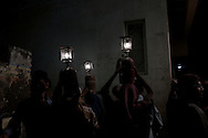 Men and women carry gas-lit lamps on their heads during the Nakadia Festival, a Festival  of Happiness and Togetherness. Varanasi, India.